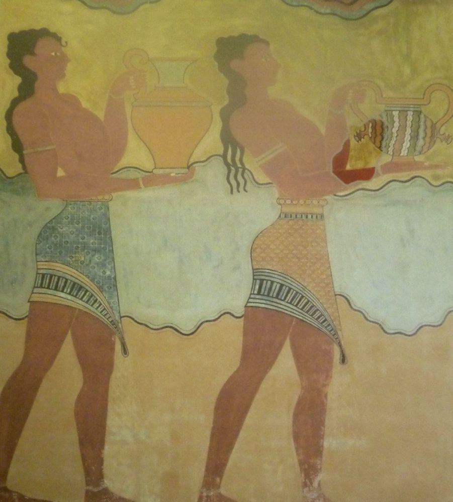 Eine Wandmalerei. Zwei Rothäutiege Männer tragen Keramik. Beide sind mit einem urzen Rock gekleidet. Sie haben lange lockieges Haar.