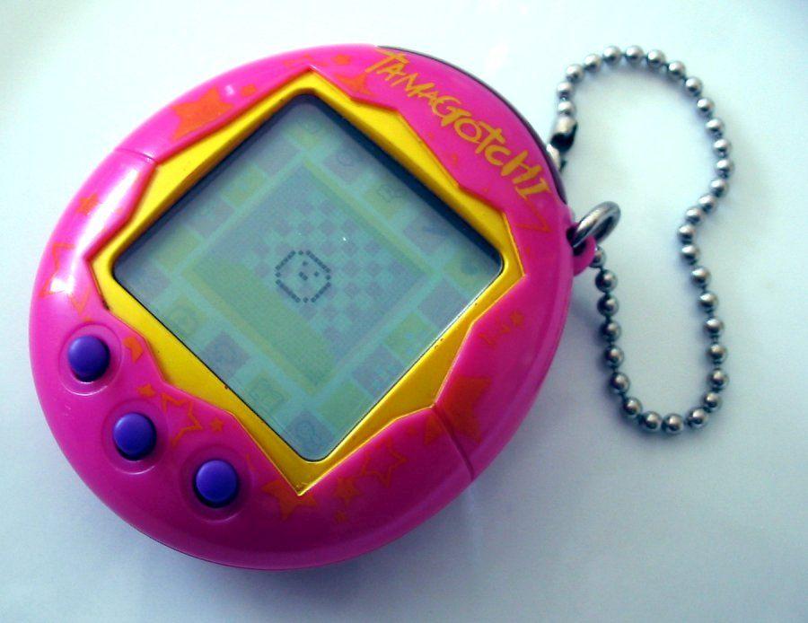 Ein Bild von einem Pinken Tamagotchi.